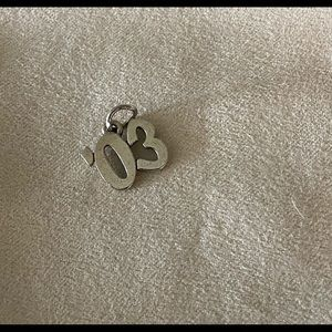 Retired James Avery 03 year charm